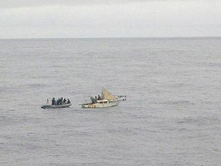 Small boat adrift at sea