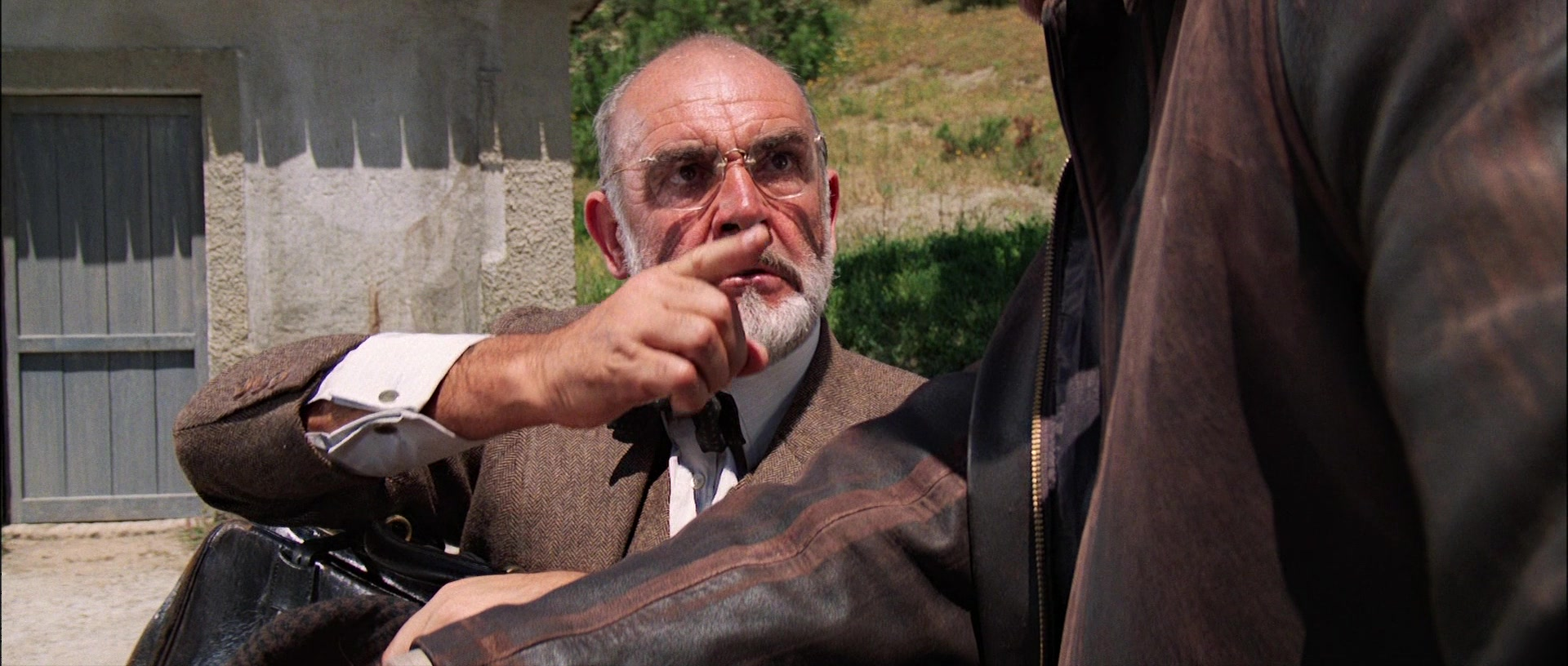 Henry Jones, Jr. (Sean Connery) confronts his son over his misue of Christ'sname.