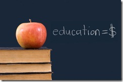 education = $ written on blackboard with apple, books