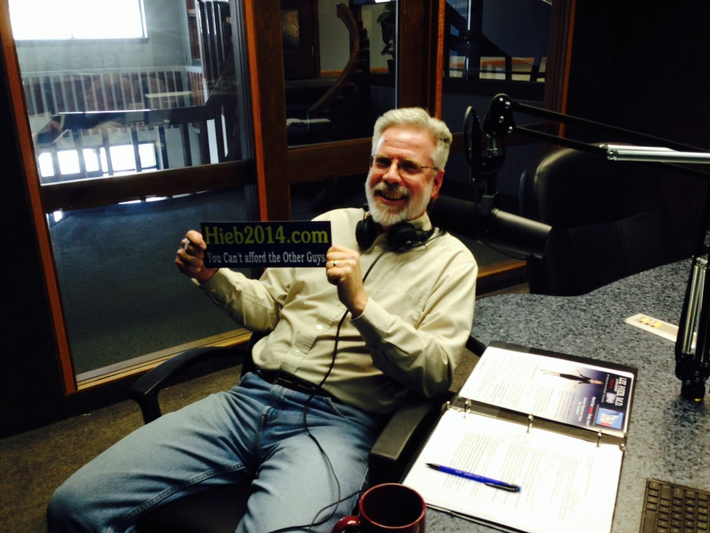 Brian models a Hieb for Governor bumper sticker since we were lame and forgot to take a picture of her when she was in studio.