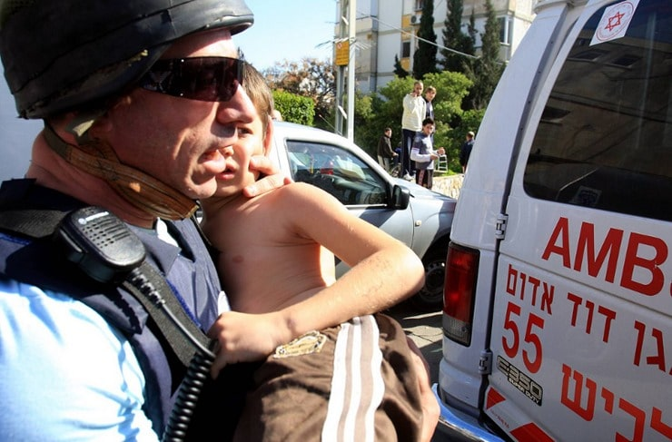 A_wounded_Israeli_Child_is_taken_to_hospital_after_Rocket_Attack