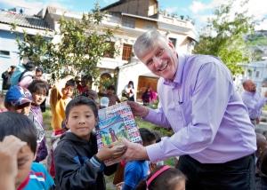 Franklin Graham, Samaritan's Purse President, distributing presents to kids.