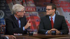 Adam Gregg (right) debates Iowa Attorney General Tom Miller.