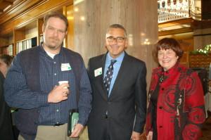 State Senator Matt McCoy (D-Des Moines) pictured in the center.