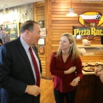 Mike Huckabee with press at Council Bluffs Pizza RanchPhoto credit: Dave Davidson - Prezography.com