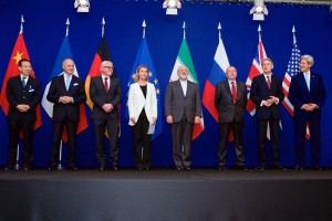 "The ministers of foreign affairs and other officials from the P5+1 countries, the European Union and Iran while announcing the framework of a Comprehensive agreement on the Iranian nuclear programme. Hailong Wu of China, Laurent Fabius of France, Frank-Walter Steinmeier of Germany, Federica Mogherini of the European Union, Javad Zarif of Iran, an unidentified official of Russia, Philip Hammond of the United Kingdom and John Kerry of the United States in the ""Forum Rolex"" auditorium of the EPFL Learning Centre, Écublens-Lausanne, Switzerland on 2 April 2015."