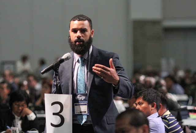A delegate addresses the United Methodist 2016 General Election in Portland, OR.