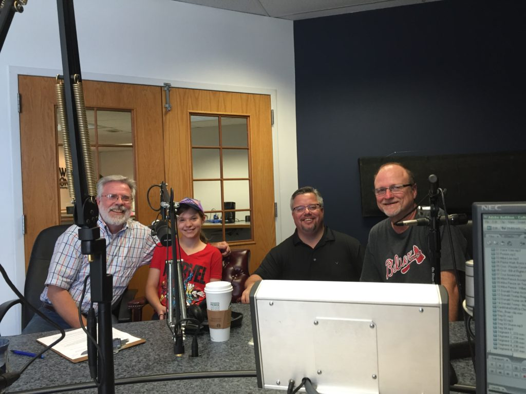 A full studio at 99.3 fm The Truth! Photo credit: Ron CarlsonFrom left: Brian Myers, Brian's granddaughter Geneva Ives, Shane Vander Hart, and Bart Munson.
