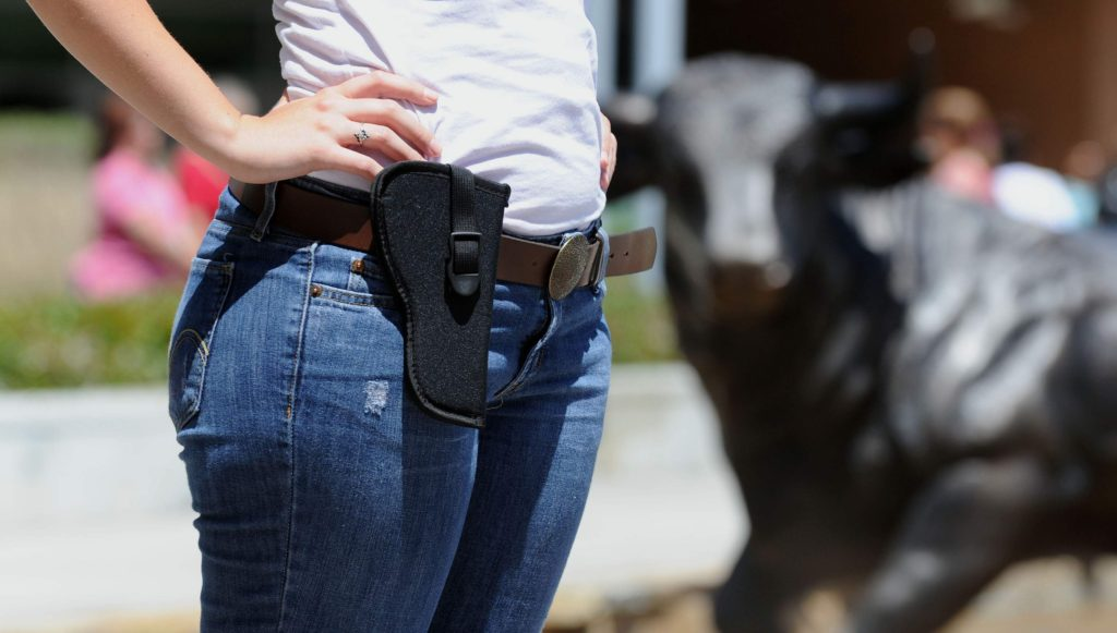 Emily Schwab, a University of South Florida student, wears an empty holster in protest for campus carry.Photo: Jim Reed/The Tampa Tribune