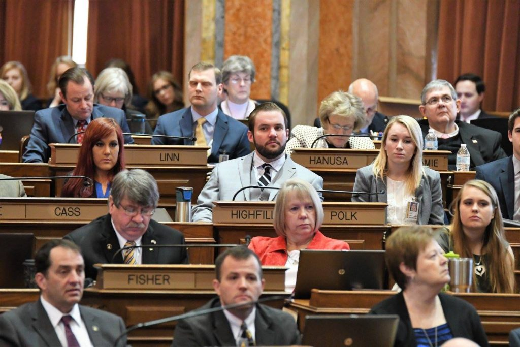 State Representatives and their clerks watch Iowa House 2017 Opening Day remarks.